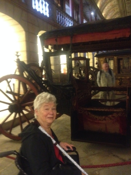 Kathleen in the carriage museum in Belem, Portugal